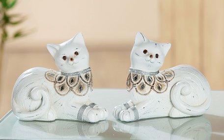 Liggende katten wit