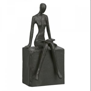 Sculptuur lezen vrouw