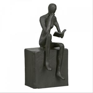 Sculptuur lezen man